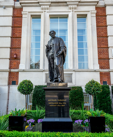 A statue of English chemist and physicist Michael Faraday in front of Royal Institution in London, England Editorial