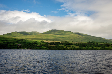 Cloudy summer highlands landscape at Loch Tay scenic coastline, central Scotland