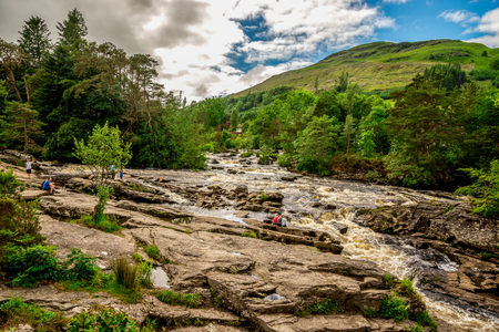 A spectacular view to Falls of Dochart from the bridge in a town of Killin, central Scotland