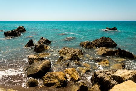 Dangerous rocks and reefs near beach in Pissouri bay, Limassol district, Cyprus Stock Photo