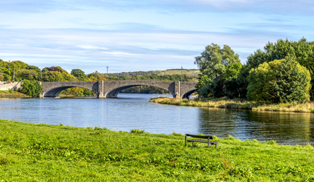 A scenic view of am ached bridge and river Dee in a beautiful sunny day, Aberdeen, Scotland