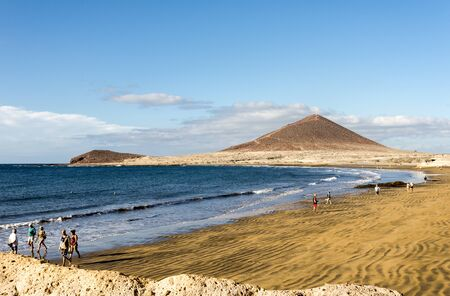 People walking on Playa de Leocadio Machado beach near El Medano town, Tenerife, Spain Redactioneel