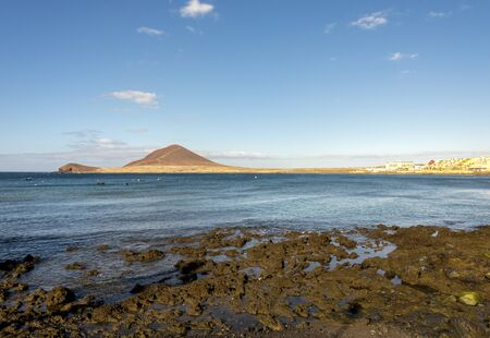 A distant view of Mount Roja and Play de Leocadio Machado beach near El Medano town, Tenerife, Spain Redactioneel