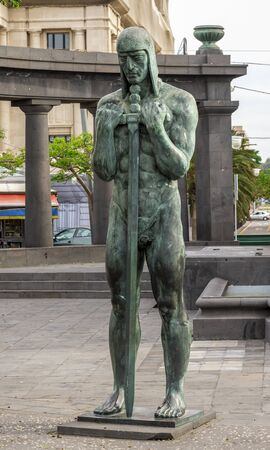 A bronze statue of the soldier with two-hand sword in front of the War Memorial at Spain square, Santa Cruz de Tenerife, Canary Islands, Spain