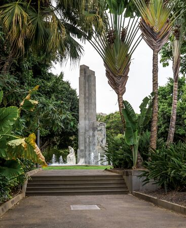A view of Garcia Sanabria monument from one of the alleys leading to the center of the park, Santa Cruz de Tenerife, Canary Islands, Spain