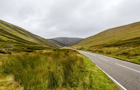 A scenic road through Cairngorms national park near Lecht ski centre, Scotland