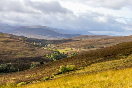 A scenic view of red and brown hills and highlands in Cairngorms national park, Scotland Stockfoto
