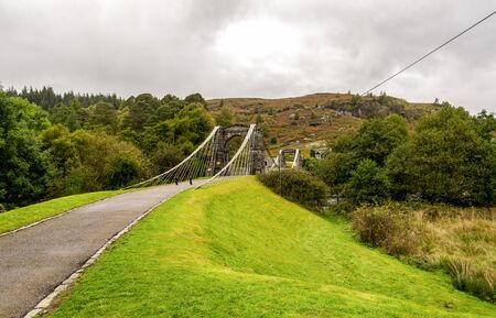 A taper suspension Bridge of Oich entrance near Aberchalder swing bridge, Scottish Highlands