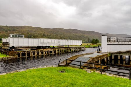 Opened Aberchalder swing bridge waiting for a boat to enter the Caledonian Canal from Loch Oich, Scotland
