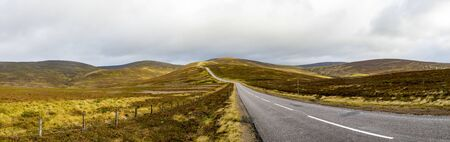 Panorama of a scenic road through Cairngorms national park highlands in autumn, Scotland