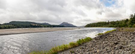 A panoramic view of River Pattack flowing to the head of Loch Laggan and Scottish highlands on the background, Cairngorms National park, Scotland
