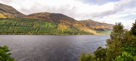 A beautiful Loch Lochty panoramic view and its northern shores with scenic hills in autumn season, Scottish Highlands Stockfoto