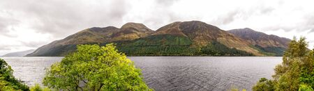 A panorama of Loch Lochty freshwater lake from the southern side in autumn season, Scotland
