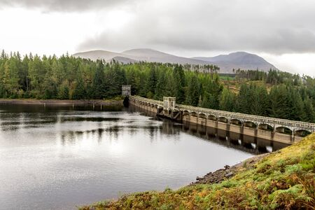 Laggan Dam holding lake's waters from entering River Spean, Scotland