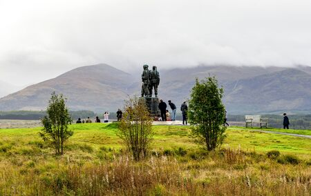 Tourists visiting the Commando Memorial monument in a cloudy weather near Spean Bridge village, Lochaber, Scottish Highlands