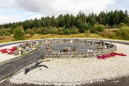 Red wreathes around Garden of Remembrance at the Commando Memorial, Lochaber, Scotland