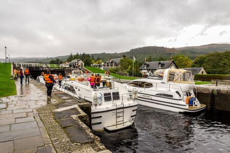 Boats waiting for locks to be opened to enter the Caledonian Canal from Loch Ness in Fort Augustus, Scotland