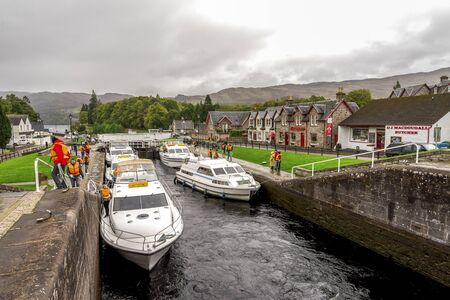 Boats parked between the locks and people waiting to enter the Caledonian Canal in Fort Augustus near Loch Ness, Scotland