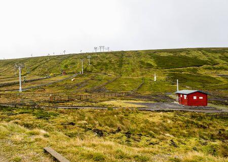 A view of empty Lecht ski centre, slopes and ski lift during autumn, Cairngorms National Park, Scotland Redactioneel