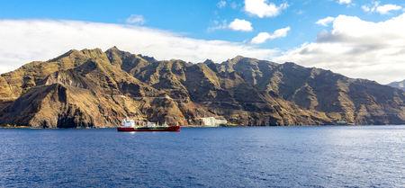 LPG boat near Tenerife coastline with Anaga mountains on background, Canary Islands, Spain