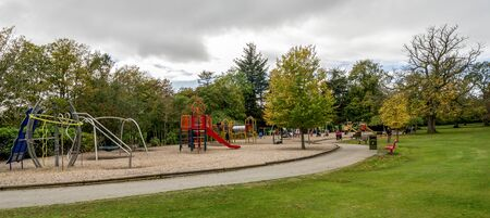 Large children playground area with slides, bars, swings and other equipment in Hazlehead park, Aberdeen, Scotland