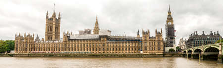 Houses of Parliament and Big Ben clock tower covered with scaffolding for restoration, London, England