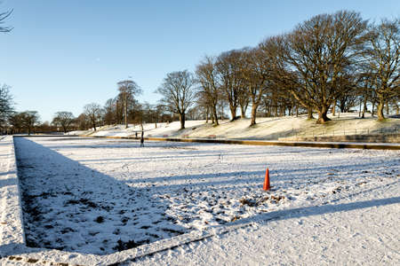 Various playground equipment outside in winter time in Seaton Park, Aberdeen, Scotland Stock Photo