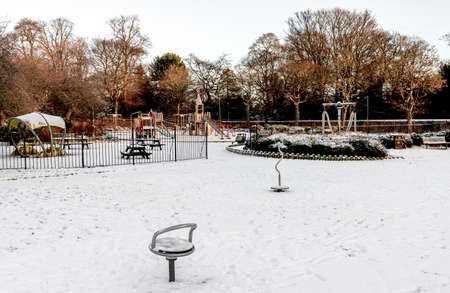 An entrance to children playground covered with snow in Westburn park, Aberdeen, Scotland