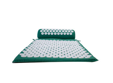 Acupressure mat and pillow set for back and neck pain relief and muscle relaxation isolated on white background. Relieves stress, pain.