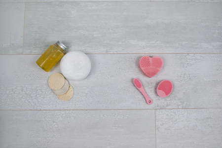 Top view cosmetic products for cleansing face or body. Sponges, cream, lotion, bottle. Stock fotó