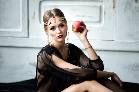Beautiful girl in a black negligee