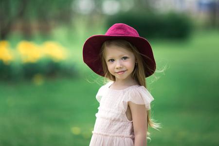 Beautiful girl in a burgundy hat