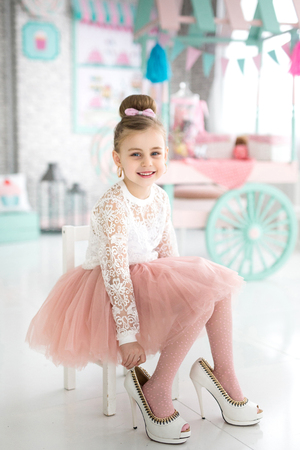 BeautifulGirl in mother's shoes