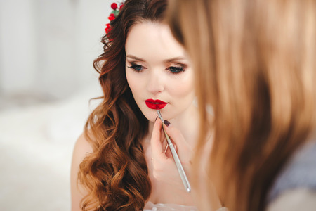 makeup artist preparing bride before the wedding in a morning Stok Fotoğraf