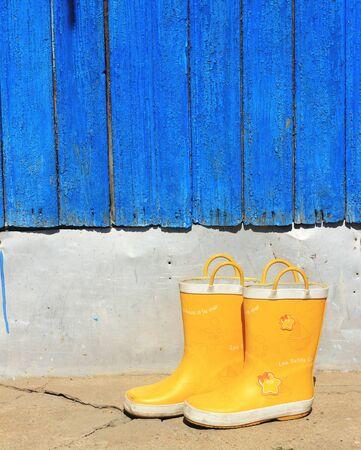 funny gumboots for children's walks outdoor and adventures in the summer in the village Stock fotó
