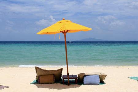 Yellow umbrella on the beach, Phi Phi island, Thailand