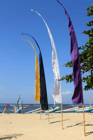 Colorful flags and outrigger boats in Bali