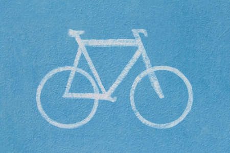 Bicycle road sign on blue background