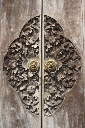 Detail of carved wooden door, Bali