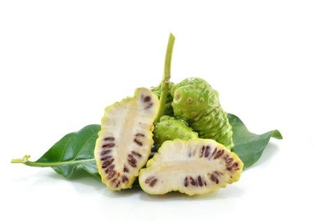 Noni fruits on white isolated background