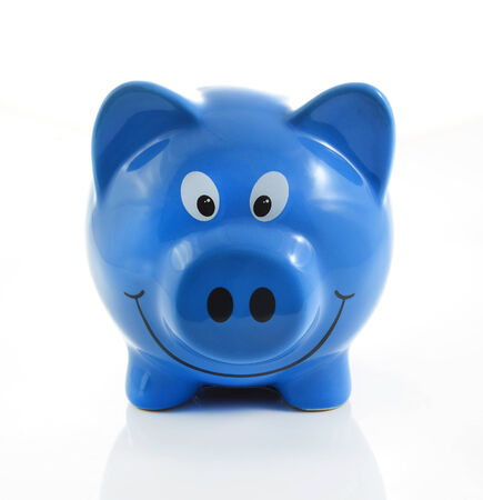 Blue piggy bank or money box isolated on a white studio background.