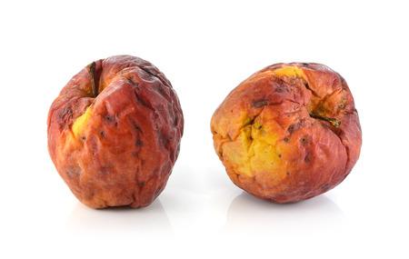Rotten apple isolated on white background photo