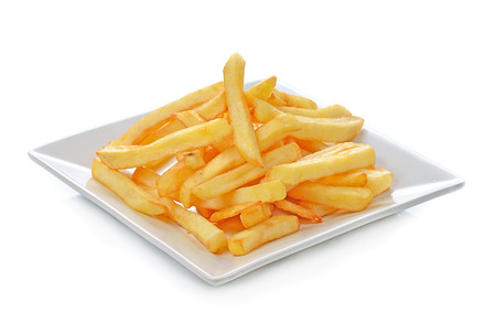 french fried potato: Potatoes fries in the plate isolated on white