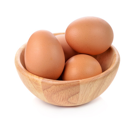 egg: eggs in a wooden bowl isolated on white background