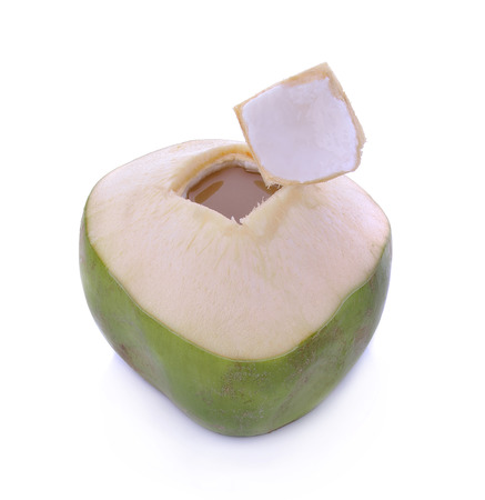 isolated on green: Green coconuts with drinking straw isolated Stock Photo