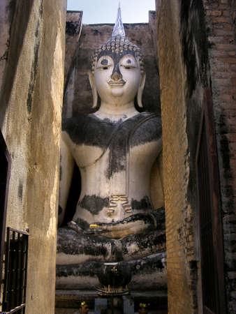 stillness: Pra Ajana at Wat Si Chum, Sukhothai Historical Park, Thailand.