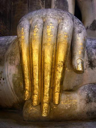 ajana: The hand of Pra Ajana at Wat Si Chum, Sukhothai Historical Park, Thailand.