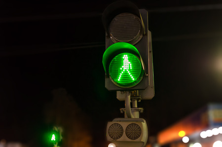 The green traffic light is on.The signal allows the passage of the railway. The green signal shows the figure of the person walking.