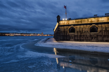 Naryshkinsky bastion of the Peter and Paul Fortress against the background of the Neva embankment. St. Petersburg. Russia. Evening. Winter.