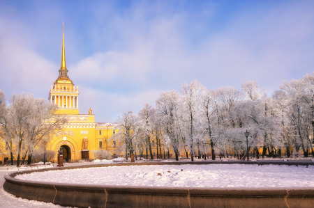 Admiralty building in St. Petersburg, Russia on a winter sunny morning. The trees in the park are covered with white frost. Background.